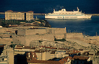 Cruise ship passing the Palais du Pharo and Saint Nicholas fort along the coast of Marseille, France.