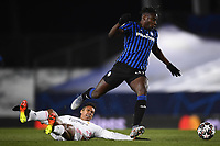 16th March 2021; Madrid, Spain; during the Champions League match, round of 16, between Real Madrid and Atalanta;  Duvan Zapata slide tackled by Raphael Varane