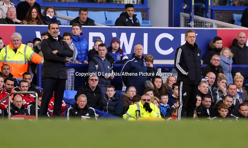 Pictured L-R: Managers Roberto Martinez of Everton and Garry Monk of Swansea. Sunday 16 February 2014<br /> Re: FA Cup, Everton v Swansea City FC at Goodison Park, Liverpool, UK.