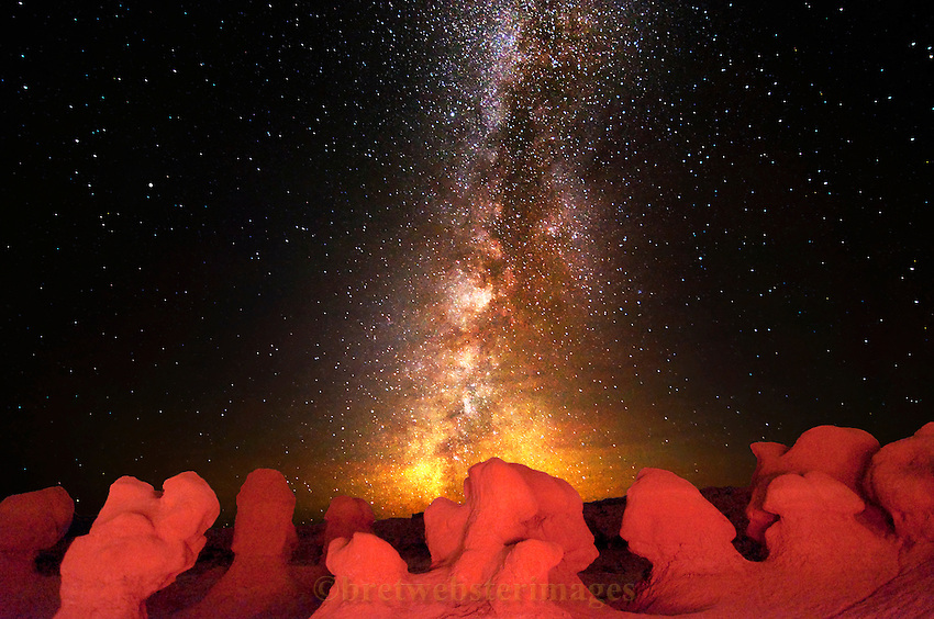 The Milky Way oversees a collection of hoodoos in Goblin Valley on a fall evening. Haze in the air adds color to the Milky Way near the horizon.
