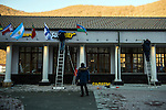 KRASNAYA POLYANA, RUSSIA  - JANUARY 5:<br /> Workers hang flags at the Gorky Gorod hotel complex in the Mountain Cluster before the start of the 2014 Sochi Olympics Wednesday February 5, 2014<br /> (Photo by Chris Detrick/The Salt Lake Tribune)