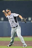 Oakland Golden Grizzlies third baseman Ben Hart (14) makes a throw to first base against the Michigan Wolverines on May 17, 2016 at Ray Fisher Stadium in Ann Arbor, Michigan. Oakland defeated Michigan 6-5 in 10 innings. (Andrew Woolley/Four Seam Images)