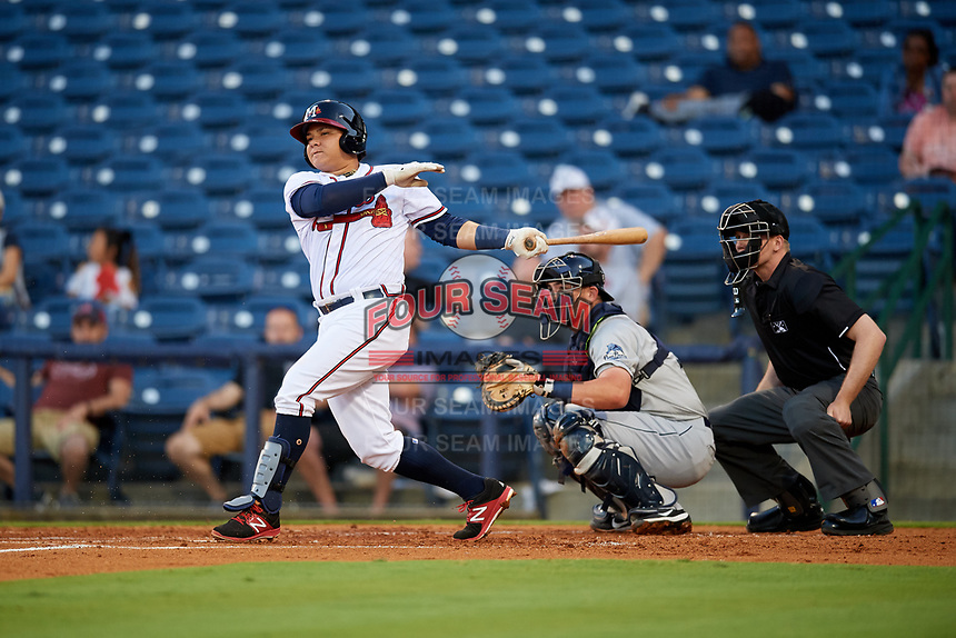 Mississippi Braves first baseman Jonathan Morales (9) grounds out in front of catcher Michael Barash (16) and home plate umpire Matt Winter during a game against the Mobile BayBears on May 7, 2018 at Trustmark park in Pearl, Mississippi.  Mobile defeated Mississippi 5-0.  (Mike Janes/Four Seam Images)
