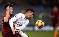 Calcio, Serie A: Roma vs ChievoVerona. Roma, stadio Olimpico, 22 settembre 2016.<br /> Roma's Stephan El Shaarawy, left, and and Chievo Verona's Mariano Izco fight for the ball during the Italian Serie A football match between Roma and Chievo Verona, at Rome's Olympic stadium, 22 December 2016.<br /> UPDATE IMAGES PRESS/Isabella Bonotto