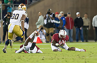 STANFORD, CA - November 30, 2013: Stanford Cardinal cornerback Wayne Lyons (2) makes a interception during the Stanford Cardinal vs the Notre Dame Irish at Stanford Stadium in Stanford, CA. Final score Stanford Cardinal 27, Notre Dame Irish  20.