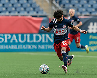 FOXBOROUGH, MA - MAY 12: Michael Tsicoulias #52 of New England Revolution II brings the ball forward during a game between Union Omaha and New England Revolution II at Gillette Stadium on May 12, 2021 in Foxborough, Massachusetts.