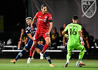 LAKE BUENA VISTA, FL - JULY 26: Omar González of Toronto FC shields away Valentín Castellanos of New York City FC as Quentin Westberg of Toronto FC clears that ball during a game between New York City FC and Toronto FC at ESPN Wide World of Sports on July 26, 2020 in Lake Buena Vista, Florida.
