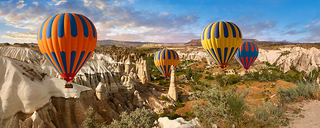 """Pictures & images of hot air balloons over the fairy chimney rock formations and rock pillars of """"love Valley"""" near Goreme, Cappadocia, Nevsehir, Turkey"""
