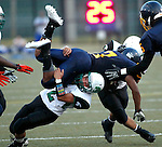 Waterbury, CT-07 September 2012-090712CM12-  Wilby's Jacob Thomas tackles Kennedy's Davon Humbles during the second quarter at the City Jamboree Friday night at Municipal Stadium in Waterbury.  Wilby would later defeat Sacred Heart for the Jamboree Championship.      Christopher Massa Republican-American