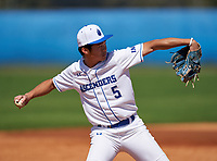 IMG Academy Ascenders Blue third baseman John Zhang (5) throws to first base during a game against the Carrollwood Day Patriots on February 20, 2021 at IMG Academy in Bradenton, Florida.  (Mike Janes/Four Seam Images)