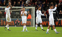 (L-R) Kyle Bartley, Neil Taylor, Ashley Williams and Kyle Naughton of Swansea thank supporters after the Barclays Premier League match between Swansea City and Bournemouth at the Liberty Stadium, Swansea on November 21 2015