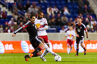 Dejan Jakovic (5) of D. C. United challenges Thierry Henry (14) of the New York Red Bulls for the ball. D. C. United defeated the New York Red Bulls 1-0 (2-1 in aggregate) during the second leg of the MLS Eastern Conference Semifinals at Red Bull Arena in Harrison, NJ, on November 8, 2012.