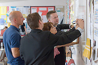 Signing up on the staffroom noticeboard, State Secondary Roman Catholic school.