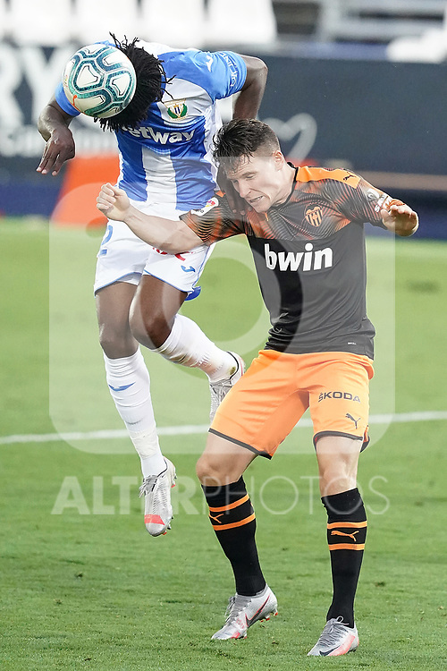 CD Leganes' Chidozie Awaziem (l) and Valencia CF's Kevin Gameiro during La Liga match. July 12,2020. (ALTERPHOTOS/Acero)