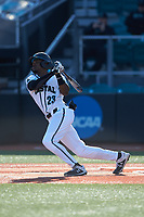 Makenzie Pate (23) of the Coastal Carolina Chanticleers follows through on his swing against the Illinois Fighting Illini at Springs Brooks Stadium on February 22, 2020 in Conway, South Carolina. The Fighting Illini defeated the Chanticleers 5-2. (Brian Westerholt/Four Seam Images)