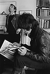 Patrick Procktor artist London 1968. Patrick with Gervase Griffiths who is reading a first copy of the Black Dwarf. Manchester Street flat. <br />