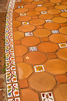 Art underfoot - inlaid tiles in a shopping mall's common area.