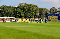 9th October 2021;  VBS Community Stadium, Sutton, London; EFL League 2 football, Sutton United versus Port Vale; teams  gather around the centre circle before the match.
