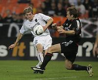 30 October,  2004.  MetroStars forward John Wolyniec (15) crosses the ball into the box past DC United's Bryan Namoff (26)  during the 2004 MLS playoffs at RFK Stadium in Washington, DC.