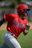 Philadelphia Phillies Luis Garcia (5) runs to first base during an exhibition game against the Canada Junior National Team on March 11, 2020 at Baseball City in St. Petersburg, Florida.  (Mike Janes/Four Seam Images)
