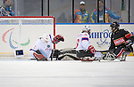 Sochi, RUSSIA - Mar 9 2014 -  Kevin Rempel has his shot stopped during Canada vs. Norway at the 2014 Paralympic Winter Games in Sochi, Russia.  (Photo: Matthew Murnaghan/Canadian Paralympic Committee)