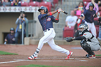 Cedar Rapids Kernels shortstop Jermaine Palacios (4) swings during a game against the Wisconsin Timber Rattlers at Veterans Memorial Stadium on April 13, 2017 in Cedar Rapids, Iowa.  The Kernels won 2-1.  (Dennis Hubbard/Four Seam Images)