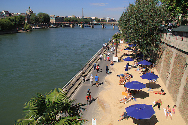 """Visitors to the """"beach"""" along the Seine River, Paris, France,"""