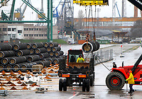 Workers arrange pipes delivered for construction of the South Stream gas pipeline and load them on a ship for unknown direction at the Black sea harbour of Varna some 450 kms (260 miles) east of the Bulgarian capital Sofia, Tuesday, Dec. 02, 2014. Russian President Vladimir Putin said on Monday that Russia would stop construction of the South Stream gas pipeline, shelving a strategically important project that Moscow was counting on to keeps  its influence in south-eastern Europe.       Photo by: Petar Petrov/Impact Press Group/NurPhoto