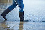 Man wading in flooded street