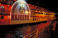 Dinner cruise boat leaves dock for a night trip on the three rivers, Ohio, Allegheny and the Monongahela. Pittsburgh Pennsylvania United States Waterfront.