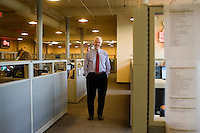 A portrait of Paul LeBlanc, president of Southern New Hampshire University, in the offices of the school's College of Online and Continuing Education (COCE) at the Riverwalk Mills Building in downtown Manchester, New Hampshire.  The COCE offices are separate from the main campus of SNHU, occupying approximately 33,000 square feet and two floors of one of the city's old industrial buildings. The COCE opened at that location about 5 years ago, and currently has plans to increase its size by another 36,000 square feet. The COCE offices are filled with admissions, advising, and other administrative personnel, currently about 150, that provide the infrastructure for students enrolled in SNHU classes worldwide...Photo by M. Scott Brauer for the Chronicle of Higher Education