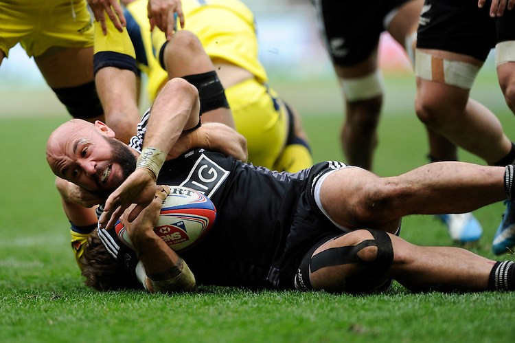 D J Forbes of New Zealand is tackled during Day Two of the iRB Marriott London Sevens at Twickenham on Sunday 11th May 2014 (Photo by Rob Munro)