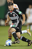 DC United forward Alecko Eskandarian (11) controls the ball during a play in the game. Los Angeles Galaxy defeated DC United 5-2, Saturday, August 26, 2006 at RFK Stadium.