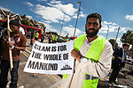 """© Joel Goodman - 07973 332324 . 30/07/2011 . London , UK.  Islamist group, Muslims Against Crusades, march through Waltham Forest in East London, calling for Sharia law to be imposed in the UK. MAC supporters carried """" Shariah Controlled Zone """" stickers, that have been appearing in parts of East London which have caused concern to some residents. Photo credit : Joel Goodman"""