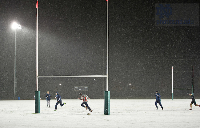 Nov. 11, 2013; Students play rugby on Stinson Rugby Field during a snow shower.<br /> <br /> Photo by Matt Cashore/University of Notre Dame