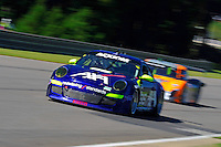 17-19  July, 2009, Birmingham, Alabama USA.#66 TRG Porsche GT3 of Kevin Buckler & Spencer Pumpelly & #60 Michael Shank Racing Ford/Riley of Oswaldo Negri & Mark Patterson..©2009 F.Peirce Williams, USA.