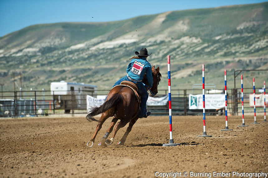 Shay Hough in the Pole Bending event at the Saturday Short Go round event at the Wyoming State High School Finals Rodeo in Rock Springs Wyoming.  Photo by Josh Homer/Burning Ember Photography.  Photo credit must be given on all uses.