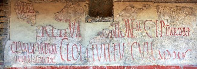 Graffitti on buildings along the Via del Abbondante, Pompeii.