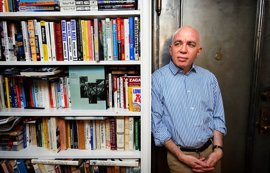 """Author Michael Wolffwho's latest book """"Fire and Fury: Inside the Trump White House,"""" has sparked a war of words between the President and former advisor Steve Bannon, is pictured in his Manhattan apartment in 2008. photo by Trevor Collens"""