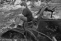 Playing on the old car, Summerhill school, Leiston, Suffolk, UK. 1968.