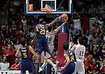 Caja Laboral Baskonia's Fernando San Emeterio (r) make the winner basket against FC Barcelona's Terence Morris during ACB Finals match. June 15,2010. (ALTERPHOTOS/Acero)