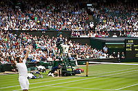 London, England, 01 July, 2016, Tennis, Wimbledon,  Stanislas Wawrinka (SUI) serves in his match against Juan Martin Del Potro (ARG)<br /> Photo: Henk Koster/tennisimages.com