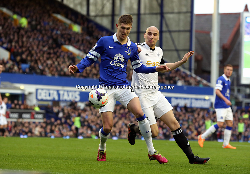 Pictured L-R: John STones of Everton is challenged by Jonjo Shelvey of Swansea.  Saturday 22 March 2014<br /> Re: Barclay's Premier League, Everton v Swansea City FC at Goodison Park, Liverpool, UK.