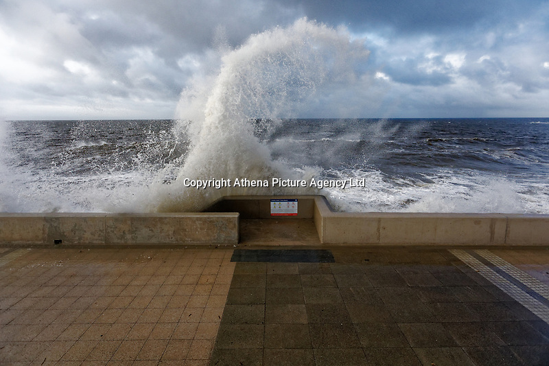 Pictured: Waves crash against the promenade wall in Porthcawl, Wales, UK. Tuesday 01 October 2019<br /> Re: Heavy rain and strong winds caused by Hurricane Lorenzo affect parts of the UK.