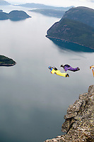 Tom Erik Heimen (left, Norway) race Shane Dunn (Australia)  during World Base Race, the first event where BASE jumpers compete to be the fastest flying down from a mountain, before deploying their parachute. The the contestants jump from a mountain in the fjord Innfjorden in Western Norway, two jumpers race each other to the finish line 750 meters horizontally from the mountain.