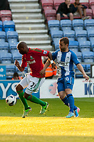 Tuesday, 7 May 2013<br /> <br /> Pictured: Dwight Tiendalli of Swansea City, Shaun Maloney of Wigan Athletic<br /> <br /> Re: Barclays Premier League Wigan Athletic v Swansea City FC  at the DW Stadium, Wigan