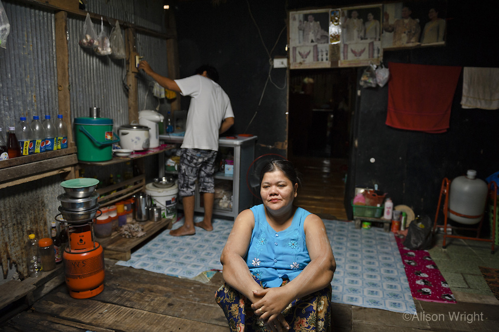 """It is estimated that over two million Burmese refugees live in Thailand, many on the island of Phuket. Many are trafficked over the northern Thai/Burma border illegally with a promise of a better life, only to find themselves locked in a vicious circle of poverty and debt. Many arrive without proper documentation or their passports and identity cards are stolen and sold for profit by the trafficker. This keeps the refugees illegal and leaves them stuck in an """"ownership"""" situation so they're unable to return to Myanmar, making them vulnerable to bribe situations by the police. The majority of migrants are forced into grueling labor on construction sites or out to sea on rickety fishing boats. They earn menial wages with no health care for their families, while owing a portion of their salaries to the traffickers who brought them into Thailand. While the men and women work under abysmal conditions in construction and fishing camps for less than $180 a month, many of their children are forced into prostitution or sold into the ubuitous Thai sex trafficking industry. The question is now that Aung San Suu Kyi has the return of her freedom and her voice is there newfound hope for the two million refugees that are unable to return to their homeland, for they too are hoping to be free."""