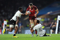 Jonny May of England is tackled by Ben Volavola of Fiji during Match 1 of the Rugby World Cup 2015 between England and Fiji - 18/09/2015 - Twickenham Stadium, London <br /> Mandatory Credit: Rob Munro/Stewart Communications
