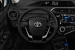 Car pictures of steering wheel view of a 2018 Toyota Prius c One 5 Door Hatchback