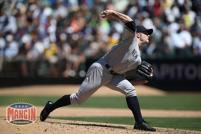 OAKLAND, CA - JUNE 13:  David Robertson #30 of the New York Yankees pitches against the Oakland Athletics during the game at O.co Coliseum on Thursday June 13, 2013 in Oakland, California. Photo by Brad Mangin